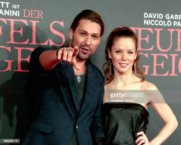 David Garrett and Andrea Deck arrive for the 'Der Teufelsgeiger' Premiere on October 24 2013 in Munich Germany