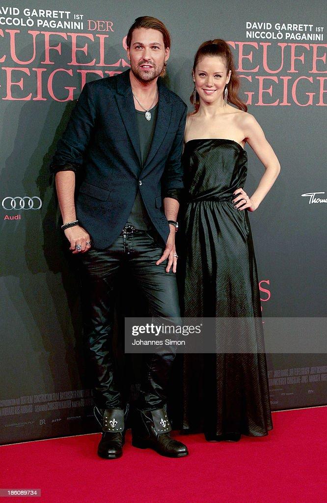 David Garrett (L) and Andrea Deck arrive for the 'Der Teufelsgeiger' Premiere on October 24, 2013 in Munich, Germany.