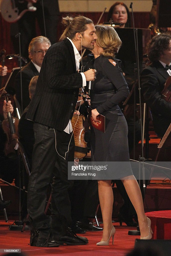 David Garrett and Kim Fisher perform during the 18th Annual Jose Carreras Gala on December 13, 2012 in Leipzig, Germany.