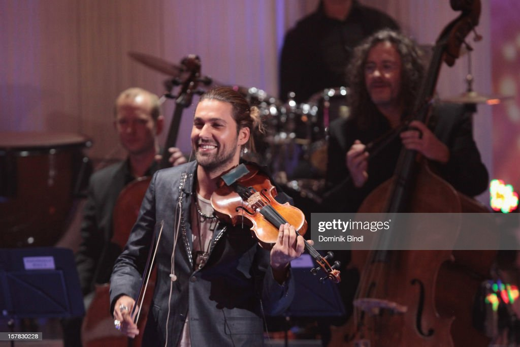 <a gi-track='captionPersonalityLinkClicked' href=/galleries/search?phrase=David+Garrett&family=editorial&specificpeople=4603343 ng-click='$event.stopPropagation()'>David Garrett</a> attends 'Die Schoensten Weihnachtshits Mit Carmen Nebel' Show on December 6, 2012 in Munich, Germany.