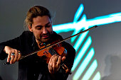 David Garrett performs at the IPO Summer Gala hosted by the British Friends of the Israel Philharmonic Orchestra at Sotheby's on April 29 2015 in...