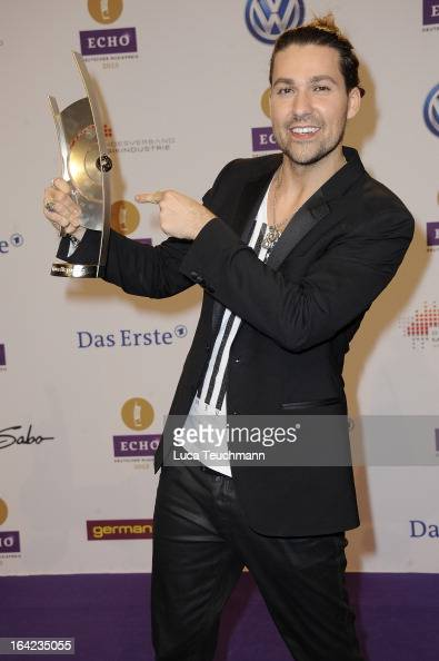 David Garrett poses with award at the Echo Awards 2013 at Palais am Funkturm on March 21 2013 in Berlin Germany