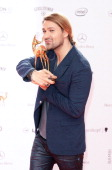 David Garrett poses with the Bambi for Classic at Stage Theater on November 14 2013 in Berlin Germany
