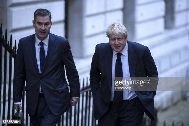David Gauke UK work and pensions secretary left and Boris Johnson UK foreign secretary arrive for a prebudget cabinet meeting at number 10 Downing...