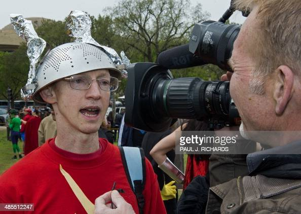 David Gayer from Silver Spring MD wears a colander strainer as a helmet for his 'Flash' costume and is intervied on TV as he waits at the US Capitol...