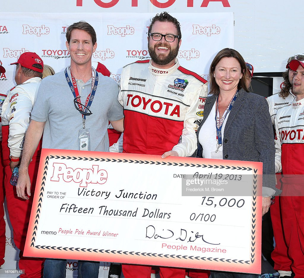 David Geithner, Ruthledge Wood and Lillie Duque with People Magazine pose with a cheque during the 37th Annual Toyota Pro/Celebrity Race qualifying on April 19, 2013 in Long Beach, California.