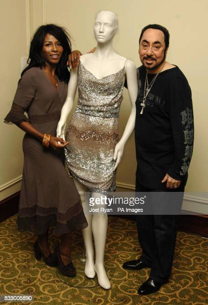 David Gest Sinitta with one of Tina Turner's dresses the sale at auction of which will benefit the Caudwell Children's Charity at Grosvenor House...