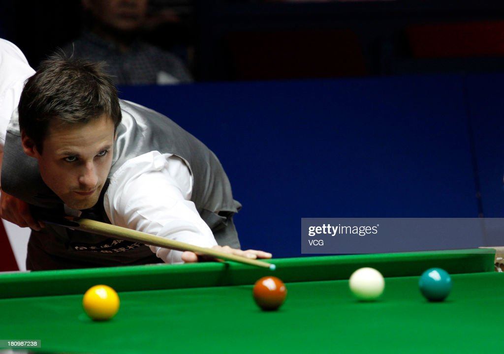 David Gilbert of England plays a shot in a match against Ding Junhui of China on day three of the 2013 World Snooker Shanghai Master at Shanghai Grand Stage on September 18, 2013 in Shanghai, China.