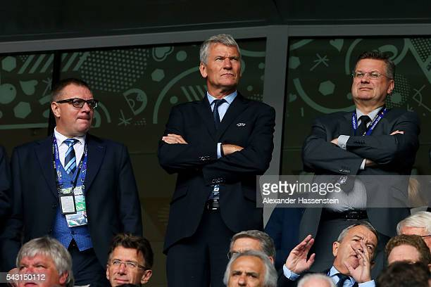 David Gill and DFB President Reinhard Grindel are seen in the stand prior to the UEFA EURO 2016 round of 16 match between Germany and Slovakia at...