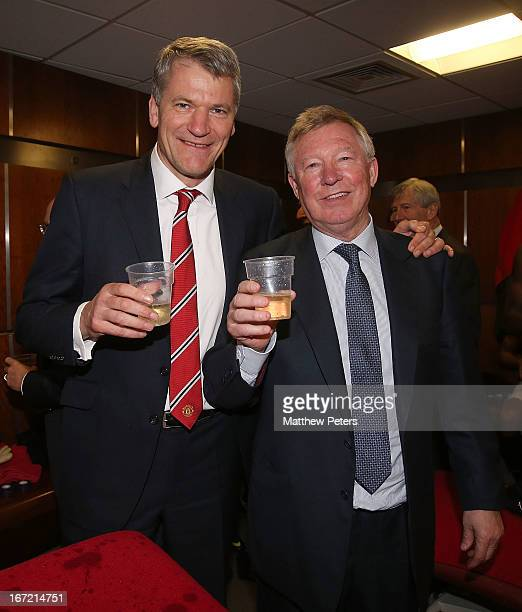 David Gill and Manager Sir Alex Ferguson of Manchester United celebrates in the dressing room after the Barclays Premier League match between...