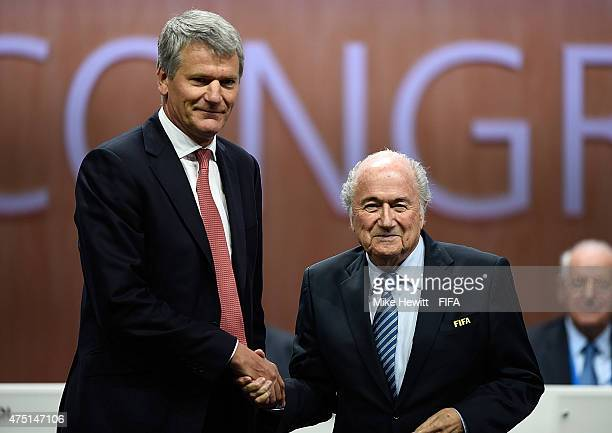 David Gill poses with FIFA President Joseph S Blatter after becoming FIFA VicePresident during the 65th FIFA Congress at the Hallenstadion on May 29...
