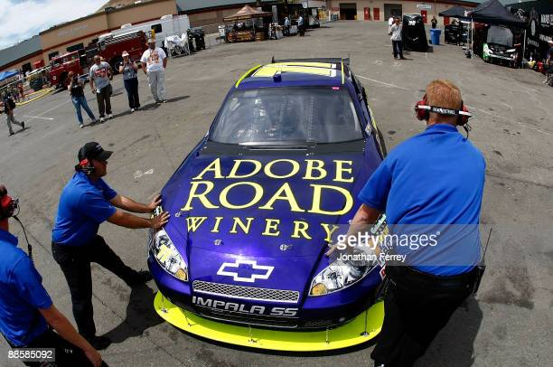 David Gilliland driver of the Adobe Road Winery Chevrolet drives in the garage during practice for the NASCAR Sprint Cup Series Toyota/Save Mart 350...