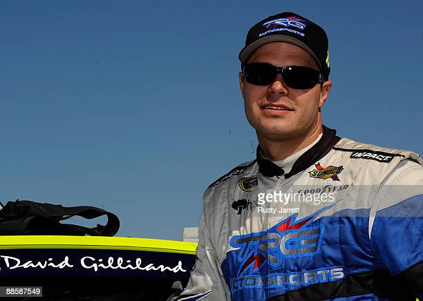 David Gilliland driver of the Adobe Road Winery Chevrolet stands by his car during qualifying for the NASCAR Sprint Cup Series Toyota/Save Mart 350...