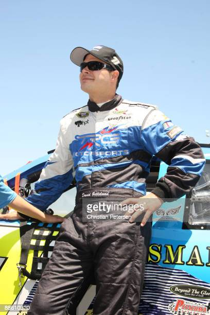 David Gilliland driver of the Adobe Road Winery Chevrolet stands on the grid prior to the start of the NASCAR Sprint Cup Series Toyota/Save Mart 350...