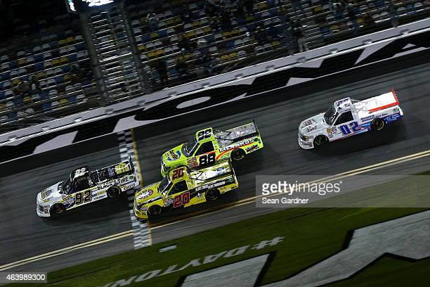 David Gilliland driver of the Blacks Tire/Goodyear Fleet HQ/Tim Cooksey Ford leads a pack of trucks during the NASCAR Camping World Truck Series...