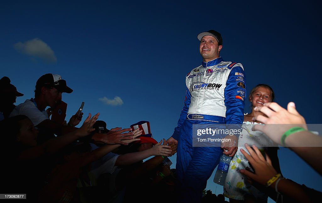 David Gilliland, driver of the #38 Long John Silver's Ford, is introduced before the NASCAR Sprint Cup Series Coke Zero 400 at Daytona International Speedway on July 6, 2013 in Daytona Beach, Florida.