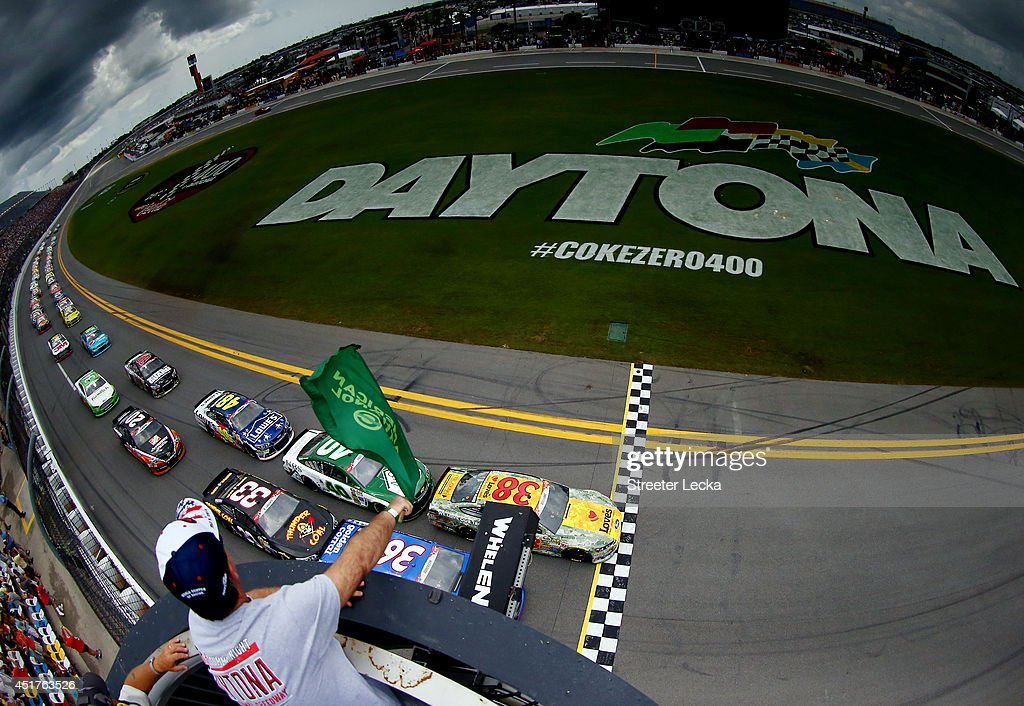 David Gilliland, driver of the #38 Love's Travel Stops Ford, and Reed Sorenson, driver of the #36 Golden Corral Chevrolet, lead the field to start the NASCAR Sprint Cup Series Coke Zero 400 at Daytona International Speedway on July 6, 2014 in Daytona Beach, Florida.