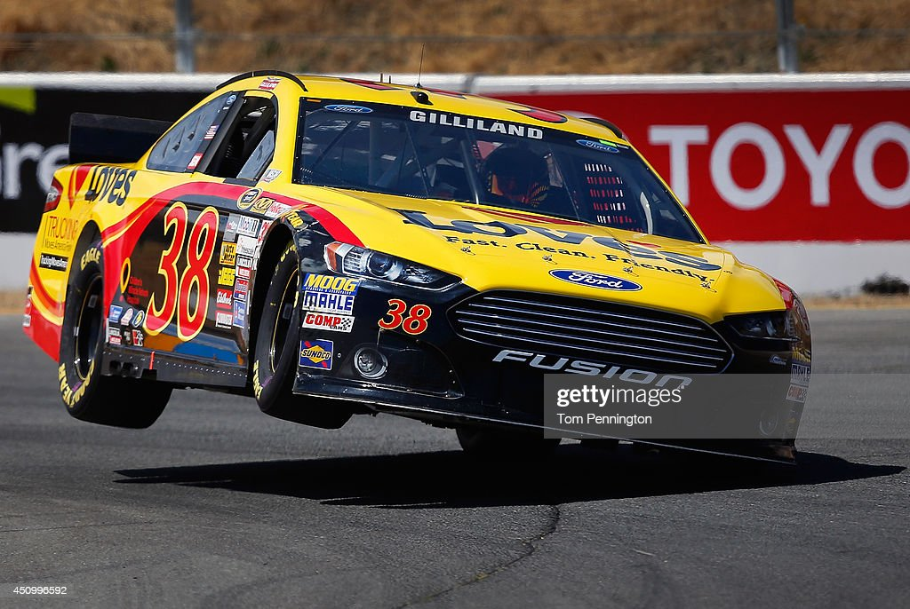 <a gi-track='captionPersonalityLinkClicked' href=/galleries/search?phrase=David+Gilliland&family=editorial&specificpeople=543432 ng-click='$event.stopPropagation()'>David Gilliland</a>, driver of the #38 Love's Travel Stops Ford, drives during qualifying for the NASCAR Sprint Cup Series Toyota/Save Mart 350 at Sonoma Raceway on June 21, 2014 in Sonoma, California.