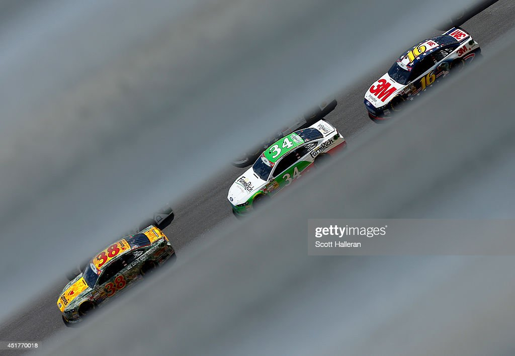 David Gilliland, driver of the #38 Love's Travel Stops Ford, leads a pack of cars during the NASCAR Sprint Cup Series Coke Zero 400 at Daytona International Speedway on July 6, 2014 in Daytona Beach, Florida.