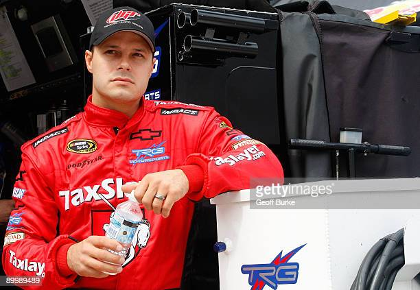 David Gilliland driver of the Tax Slayer Chevrolet stands in his pit prior to practice for the NASCAR Sprint Cup Series Sharpie 500 at Bristol Motor...