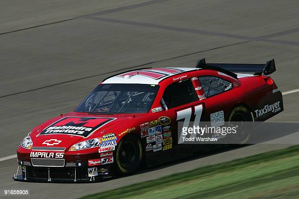 David Gilliland driver of the TRG Motorsports Chevrolet drives during practice for the NASCAR Sprint Cup Series Pepsi 500 at Auto Club Speedway on...