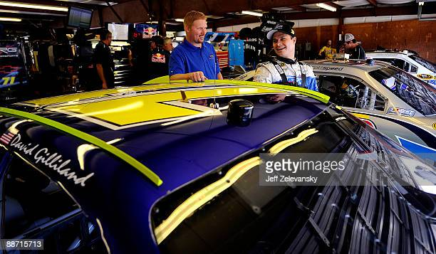 David Gilliland driver of the TRG Motorsports Chevrolet gets into his car during practice for the NASCAR Sprint Cup Series LENOX Industrial Tools 301...