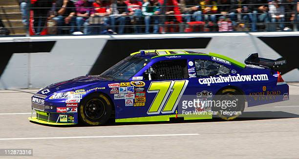 David Gilliland drives the unsponsored No 71 Chevy early in the NASCAR Sprint Cup series Samsung 500 at Texas Motor Speedway in Fort Worth Texas on...