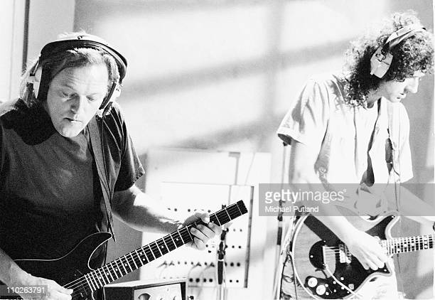 David Gilmour of Pink Floyd and Brian May of Queen in recording studio during making of Armenia earthquake appeal record London 1989 He plays a...