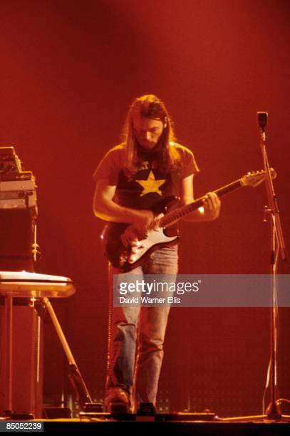 COURT Photo of PINK FLOYD and David GILMOUR David Gilmour playing Fender Stratocaster guitar using wah wah pedal performing live onstage at SHELTER...