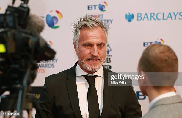 David Ginola speaks to the media on the red carpet at the BT Sport Industry Awards 2015 at Battersea Evolution on April 30 2015 in London England The...