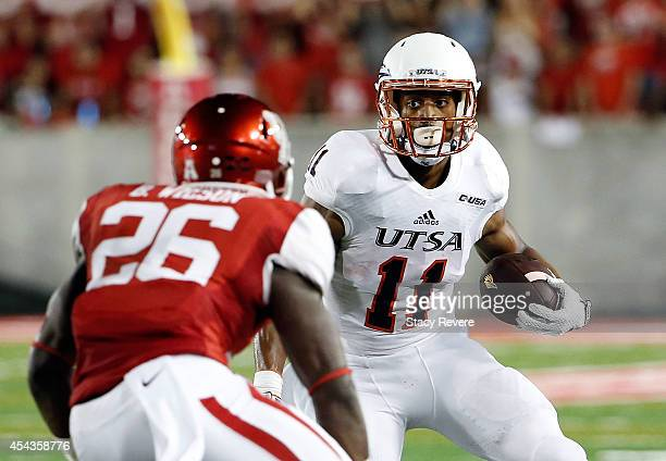 David Glasco II of the UTSA Roadrunners is pursued by Brandon Wilson of the Houston Cougars during a game at TDECU Stadium on August 29 2014 in...