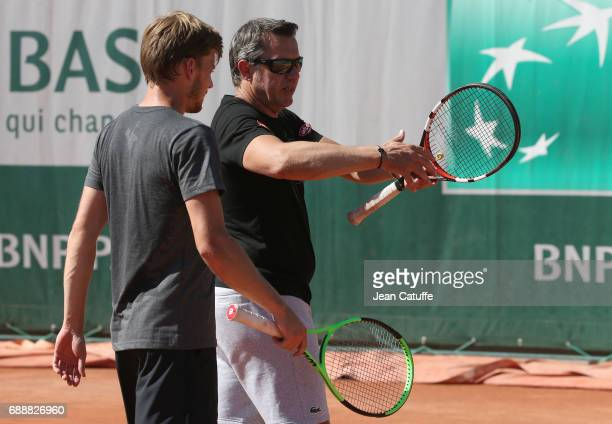David Goffin of Belgium and his coach Thierry Van Cleemput during practice three days ahead of the start of 2017 French Open at Roland Garros stadium...