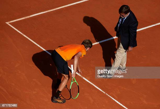 David Goffin of Belgium appeals to chair umpire after a bad line call during the men's singles semifinal match against Rafael Nadal of Spain during...