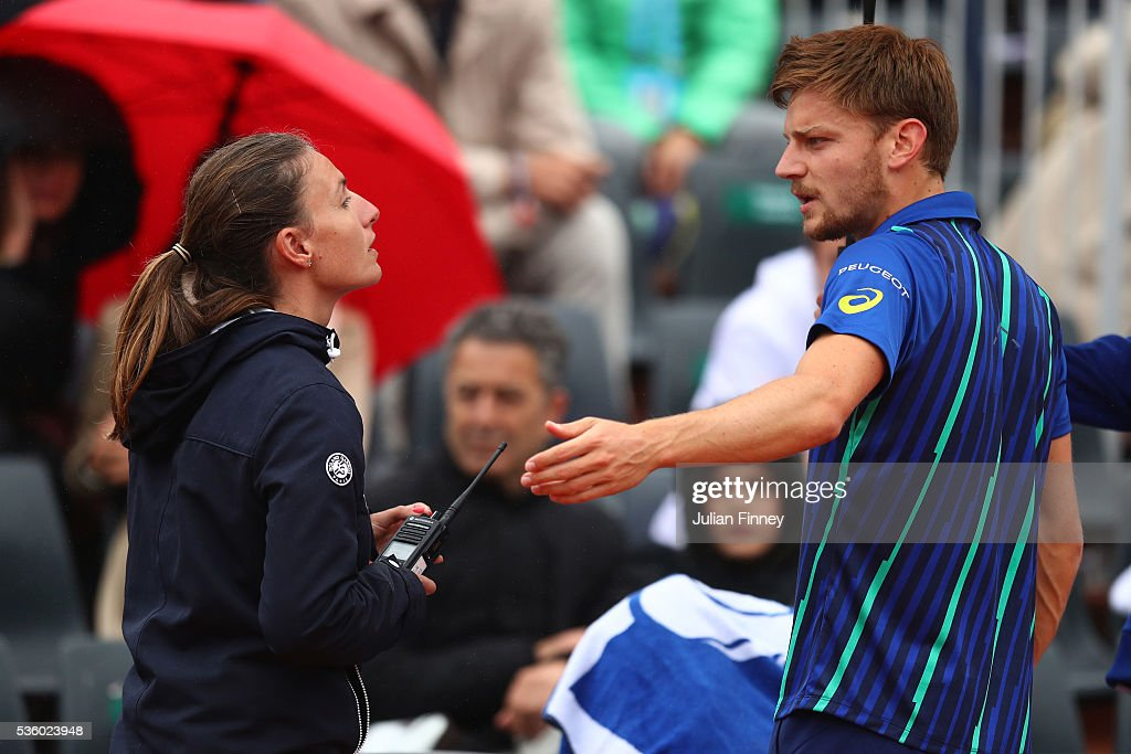 <a gi-track='captionPersonalityLinkClicked' href=/galleries/search?phrase=David+Goffin&family=editorial&specificpeople=2291768 ng-click='$event.stopPropagation()'>David Goffin</a> of Belgium attempts to walk off court because of the falling rain, but is stopped by the Umpire during the Men's Singles fourth round match against Ernests Gulbis of Latvia on day ten of the 2016 French Open at Roland Garros on May 31, 2016 in Paris, France.