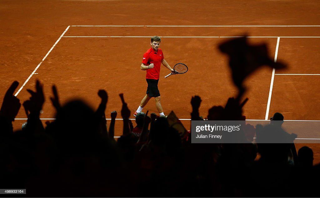 <a gi-track='captionPersonalityLinkClicked' href=/galleries/search?phrase=David+Goffin&family=editorial&specificpeople=2291768 ng-click='$event.stopPropagation()'>David Goffin</a> of Belgium celebrates after winning the fourth set during the singles match against Kyle Edmund of Great Britain on day one of the Davis Cup Final 2015 at Flanders Expo on November 27, 2015 in Ghent, Belgium.