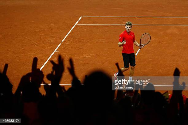 David Goffin of Belgium celebrates after winning the fourth set during the singles match against Kyle Edmund of Great Britain on day one of the Davis...