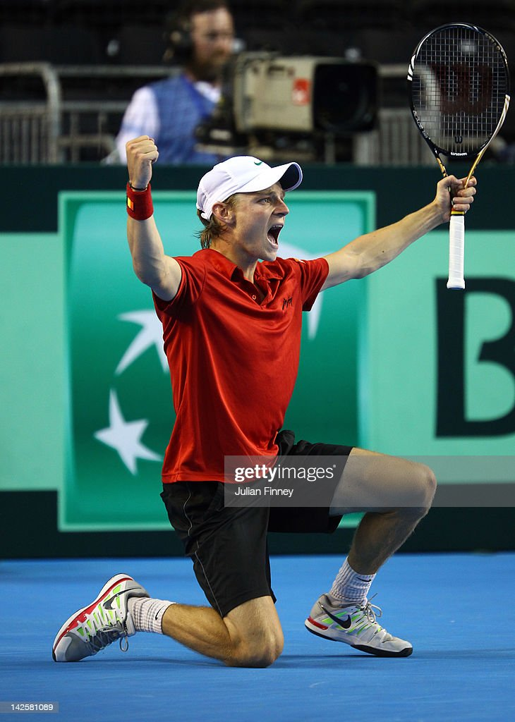 <a gi-track='captionPersonalityLinkClicked' href=/galleries/search?phrase=David+Goffin&family=editorial&specificpeople=2291768 ng-click='$event.stopPropagation()'>David Goffin</a> of Belgium celebrates defeating Josh Goodall of Great Britain during day three of the Davis Cup match between Great Britain and Belgium at the Braehead Arena on April 8, 2012 in Glasgow, Scotland.