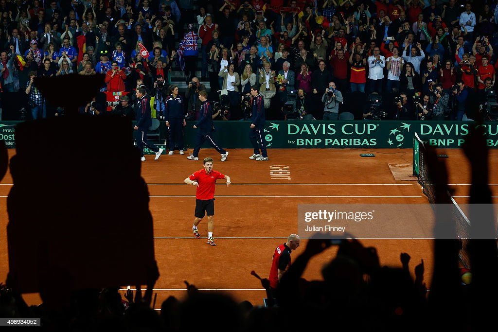 <a gi-track='captionPersonalityLinkClicked' href=/galleries/search?phrase=David+Goffin&family=editorial&specificpeople=2291768 ng-click='$event.stopPropagation()'>David Goffin</a> of Belgium celebrates his victory during the singles match against Kyle Edmund of Great Britain on day one of the Davis Cup Final 2015 at Flanders Expo on November 27, 2015 in Ghent, Belgium.