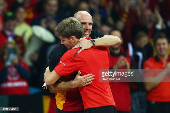 David Goffin of Belgium celebrates his victory with Johan Van Herck the Captain of Belgium during the singles match against Kyle Edmund of Great...