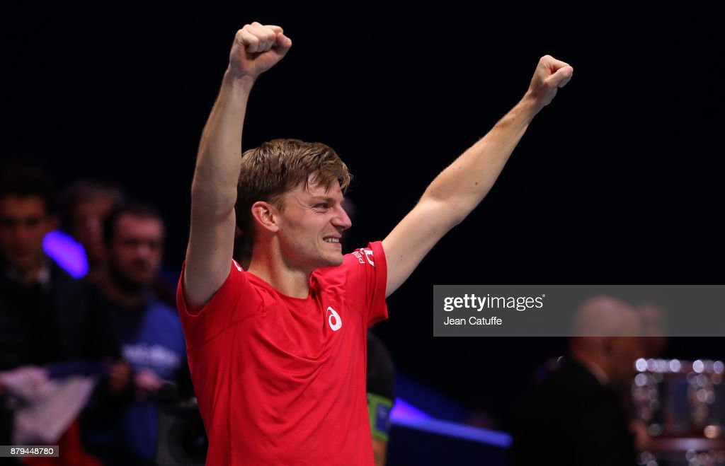 David Goffin of Belgium celebrates winning his match against Jo-Wilfried Tsonga of France during day 3 of the Davis Cup World Group final between France and Belgium at Stade Pierre Mauroy on November 26, 2017 in Lille, France.