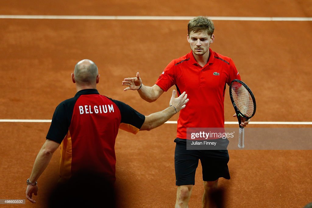<a gi-track='captionPersonalityLinkClicked' href=/galleries/search?phrase=David+Goffin&family=editorial&specificpeople=2291768 ng-click='$event.stopPropagation()'>David Goffin</a> of Belgium celebrates with <a gi-track='captionPersonalityLinkClicked' href=/galleries/search?phrase=Johan+Van+Herck&family=editorial&specificpeople=2182259 ng-click='$event.stopPropagation()'>Johan Van Herck</a> the Captain of Belgium during the singles match against Kyle Edmund of Great Britain on day one of the Davis Cup Final 2015 at Flanders Expo on November 27, 2015 in Ghent, Belgium.