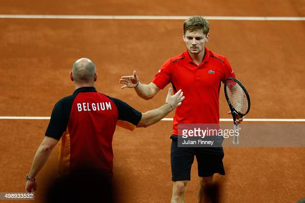 David Goffin of Belgium celebrates with Johan Van Herck the Captain of Belgium during the singles match against Kyle Edmund of Great Britain on day...