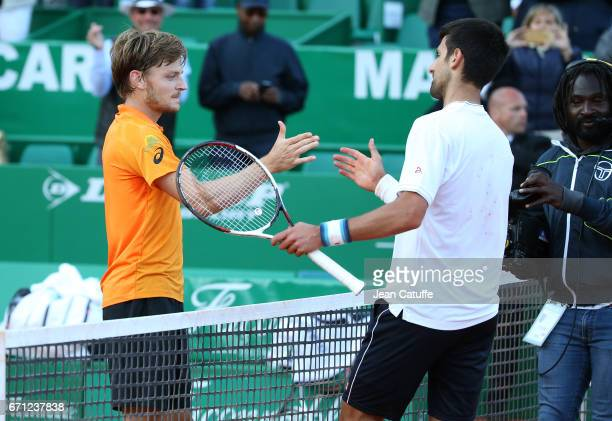 David Goffin of Belgium greets Novak Djokovic of Serbia at the net after beating him in quarter final on day 6 of the MonteCarlo Rolex Masters an ATP...