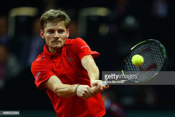 David Goffin of Belgium hits a backhand during the singles match against Kyle Edmund of Great Britain on day one of the Davis Cup Final 2015 at...