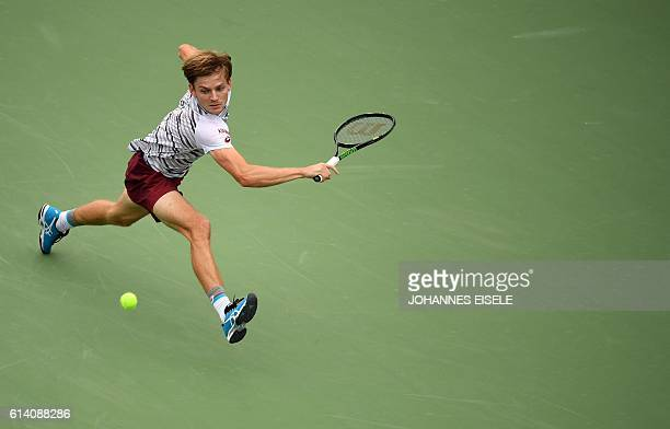 TOPSHOT David Goffin of Belgium hits a return against Benoit Paire of France hits during their men's singles match at the Shanghai Masters tennis...