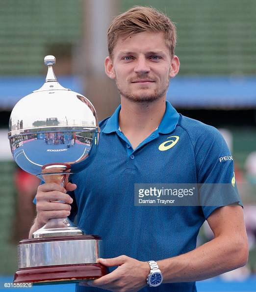 David Goffin of Belgium holds the trophy after winning the mens final against Ivo Karlovic of Croatia during day four of the 2017 Priceline Pharmacy...
