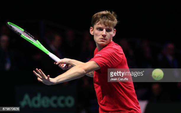 David Goffin of Belgium in action against JoWilfried Tsonga of France on day 3 of the Davis Cup World Group final between France and Belgium at Stade...