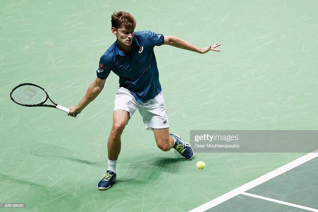 <a gi-track='captionPersonalityLinkClicked' href=/galleries/search?phrase=David+Goffin&family=editorial&specificpeople=2291768 ng-click='$event.stopPropagation()'>David Goffin</a> of Belgium in action against Marcos Baghdatis of Cyprus during day 2 of the ABN AMRO World Tennis Tournament held at Ahoy Rotterdam on February 9, 2016 in Rotterdam, Netherlands.