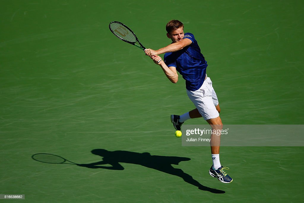 <a gi-track='captionPersonalityLinkClicked' href=/galleries/search?phrase=David+Goffin&family=editorial&specificpeople=2291768 ng-click='$event.stopPropagation()'>David Goffin</a> of Belgium in action against Milos Raonic of Canada in the semi finals during day thirteen of the BNP Paribas Open at Indian Wells Tennis Garden on March 19, 2016 in Indian Wells, California.