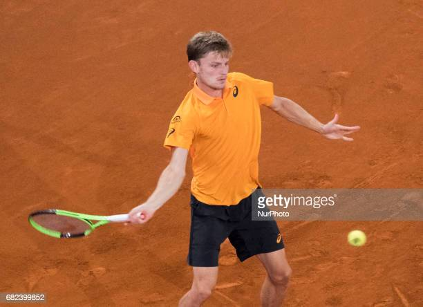 David Goffin of Belgium in action against Rafael Nadal of Spain during day seven of the Mutua Madrid Open tennis at La Caja Magica on May 12 2017 in...